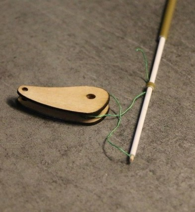 Use CA to glue the toothpick tip and the thread to the end of the elevator pushrod. Loop the string around the elliptical control.